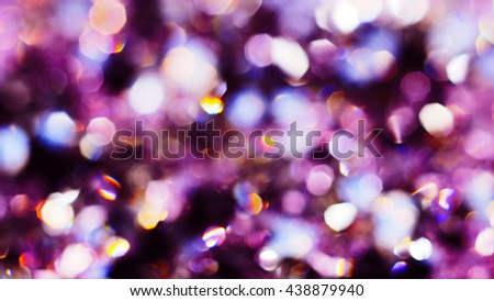 Abstract color bokeh circles background in violet tones