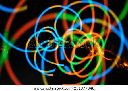 abstract color lines in the dark - stock photo