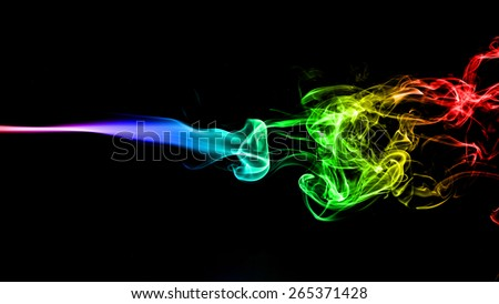 Abstract color smoke on black background. - stock photo