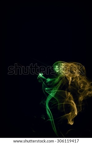 Abstract color smoke on black background, smoke background,red and green and brown ink background, red ,green, brown
