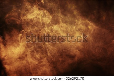 Abstract colored smoke on a dark background - stock photo