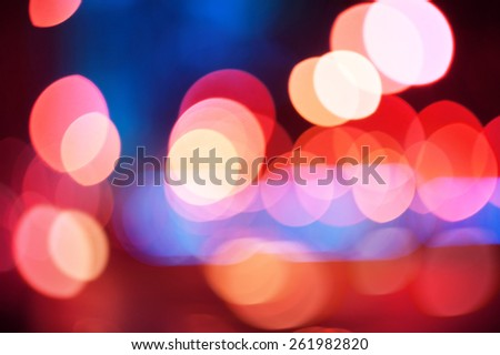 Abstract colorful blurred background with defocused lights effect - stock photo