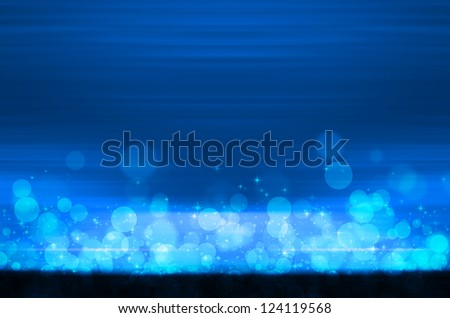 abstract colorful bokeh on blue background - stock photo