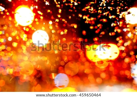 abstract colorful bokeh - water on window glass