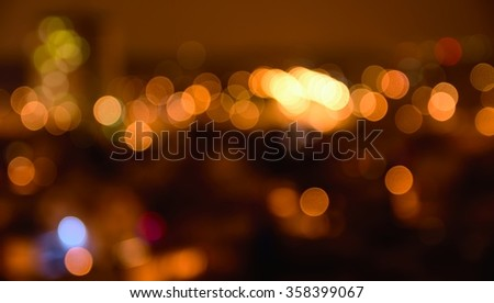 Abstract colorful defocused city lights with bokeh effects at night. Warm tone orange light background.