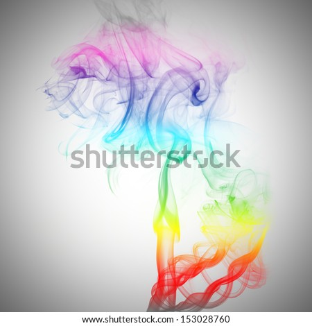 Abstract colorful fume swirls over the white background