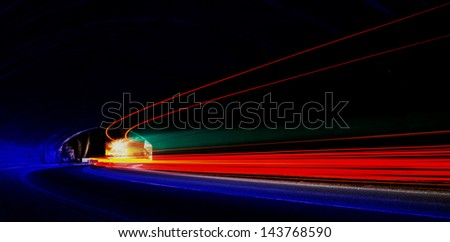Abstract colorful lights in car tunnel that can be used as background or texture