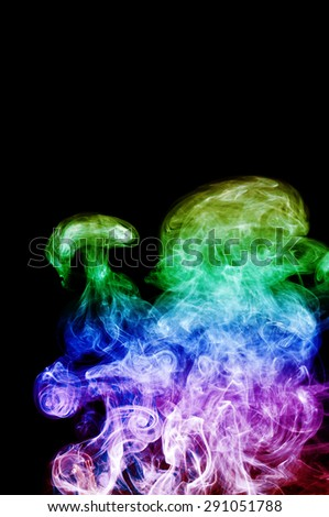 Abstract colorful smoke on black background, color background,colorful ink background - stock photo