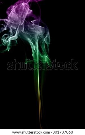 Abstract colorful smoke on black background, color background,colorful ink background,Violet, Green, Orange - stock photo