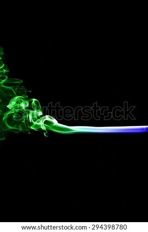 Abstract colorful smoke on black background, smoke background,colorful ink background,Blue and Green smoke, beautiful smoke - stock photo