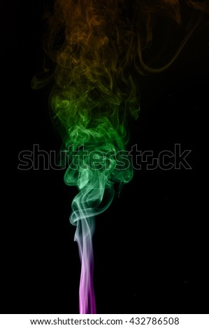 Abstract colorful smoke on black background, smoke background,colorful ink background,Violet, Green, Orange,movement of smoke