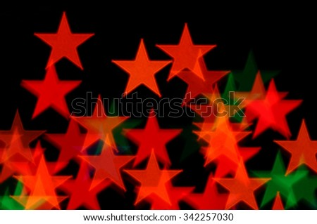 Abstract colorful stars pattern christmas lights blur on black background. - stock photo