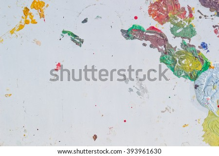 Abstract colorful texture background. Splash acrylic color on wood door.