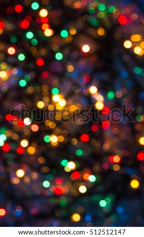 abstract colorful twinkling lights bokeh red green blue yellow background