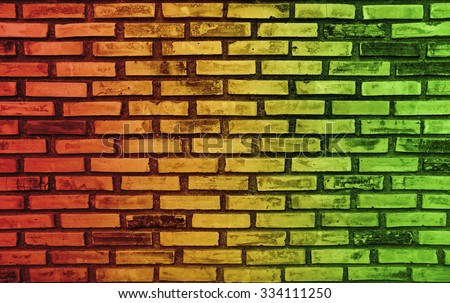 Abstract colors on brick wall background and reggae music - stock photo