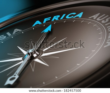 Abstract compass needle pointing the destination africa, blue and brown tones with focus on the main word. Concept image suitable for illustration of trip counseling. - stock photo