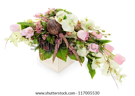 abstract composition from orchids, tulips,coconut, rocks and vines arrangement centerpiece in vase isolated on white background - stock photo