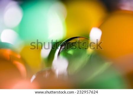 Abstract composition with beautiful, transparent, round jelly balls on an aluminium foil with reflexions and dark background  - stock photo