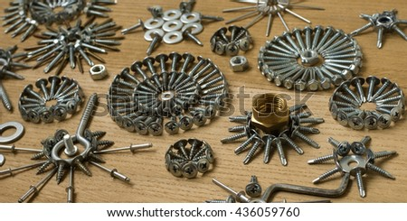 Abstract composition with fastening elements on the wooden background - stock photo