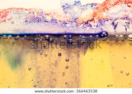 Abstract composition with mix of oil, water and colorful ink with bubbles - stock photo