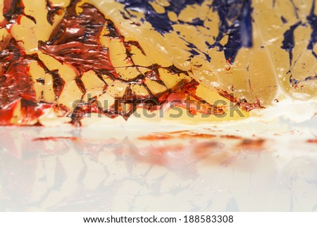 Abstract composition with pomelo and red and blue paint for oil painting with reflexions  - stock photo