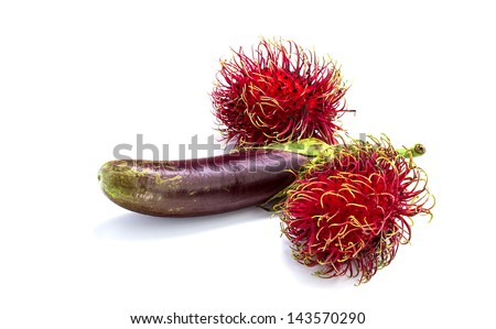 abstract condom made from eggplants and rambutan - stock photo