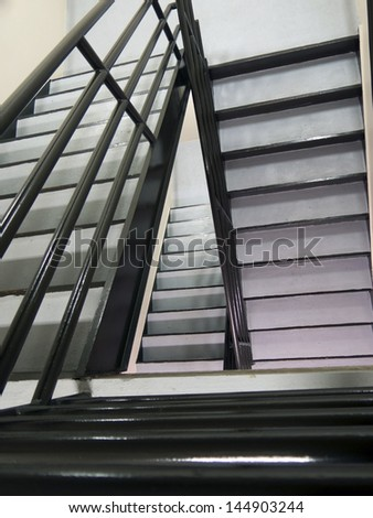 Abstract confusing staircase showing up and down step with handrails - stock photo