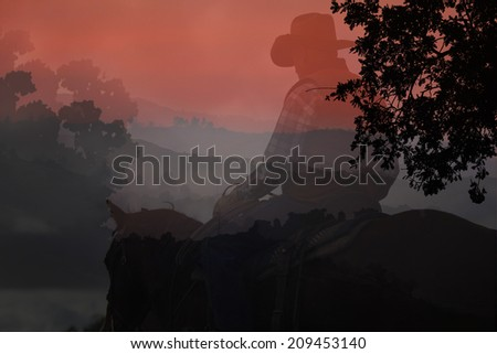 Abstract cowboy and horse in a red background with mountains and black trees. - stock photo