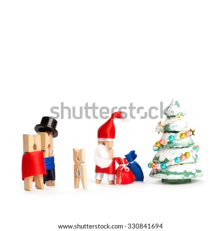 Abstract, creative congratulatory xmas postcard invitation with abstract heroes. Wooden clothespin Santa Claus, man, woman and child. waiting xmas gifts, presents. white background, copy space - stock photo