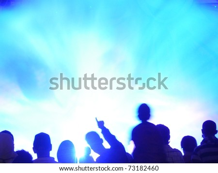 Abstract crowd of people watching light show