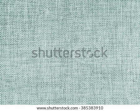 Abstract crumpled green teal color fabric texture background:rough/creased fabric textures in vintage color.wrinkle fabric burlap backdrop concept.retro garment textile wallpaper for banner template - stock photo