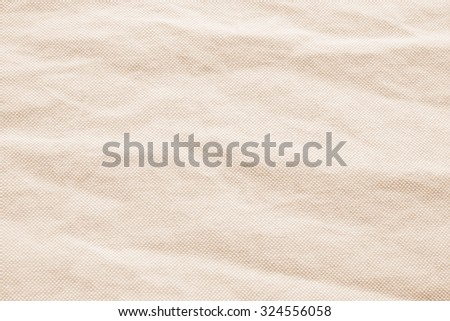 Abstract crumpled orange colored fabric texture backgrounds : creased burlap fabric textures in bright beige sepia color tone. - stock photo