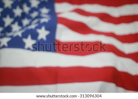 abstract crumpled retro american flag with vignette backgrounds. - stock photo