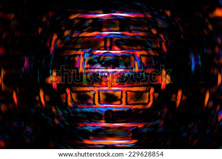 Abstract dark background of spin circle radial blur of a brick wall in black, red, and orange