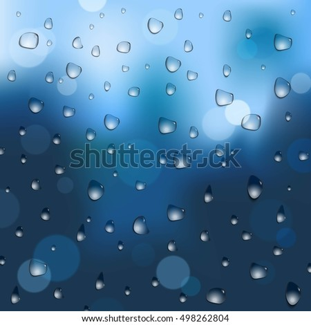 Abstract dark blue defocused background with water drops and bokeh effect.