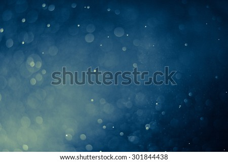 abstract dark bokeh lights background , defocused background - stock photo