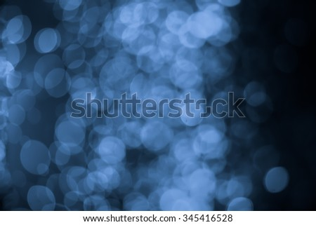 abstract dark bokeh lights background ,  defocused background, glowing galaxy
