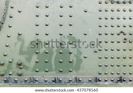 Abstract dark green industrial metal background texture with rivets - stock photo