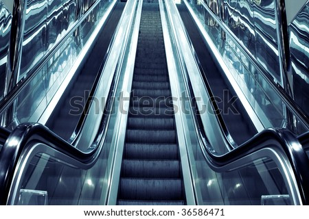 abstract dark steps of moving escalator in airport