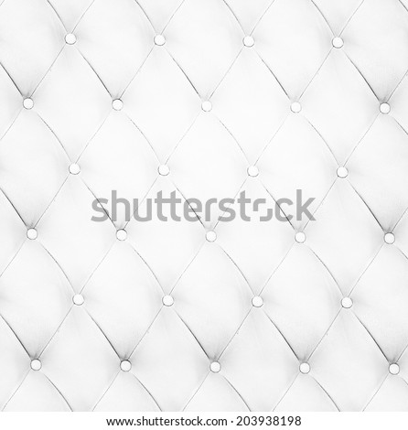 Abstract decorative background texture of an old natural luxury modern style leather with rhombs. Classic light white and dark gray grungy skin of retro wall, door, sofa, studio interior with buttons. - stock photo