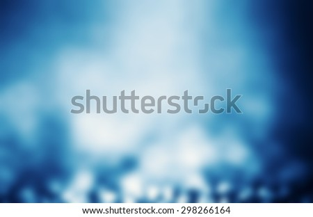 Abstract Defocused Background with magic Bokeh. Soft Blue Christmas abstract backdrop with blurry lights. 