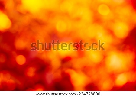 Abstract defocused background with red and gold circular blurry bokeh