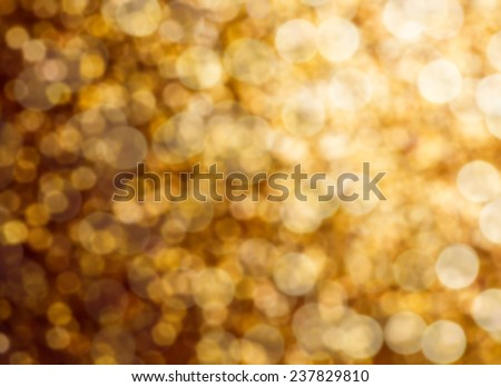 Abstract defocused gold sparkles background - stock photo