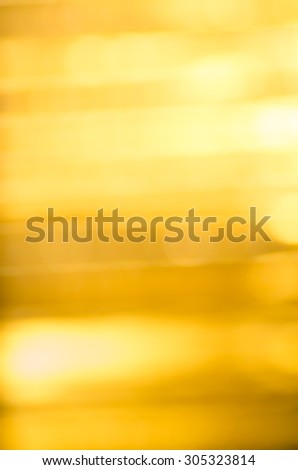 abstract defocused light golden color background texture - stock photo