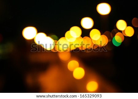 Abstract defocused lights of the night city bokeh background