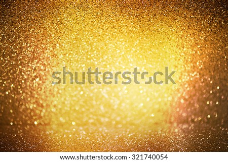 abstract defocused lights, sparkling holiday bokeh background with golden tones, elegant christmas backdrop - stock photo