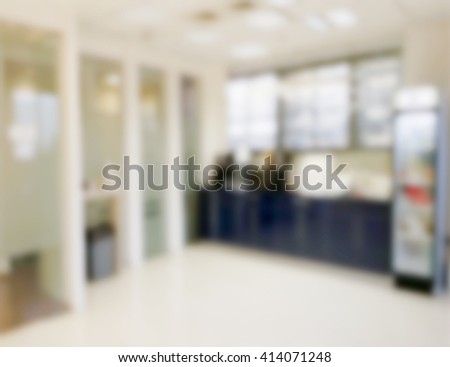 Abstract defocused office kitchen room. Defocused office inside interior. Blurred empty room with furniture. Working space background in bright colors. Clinic waiting area concept. - stock photo