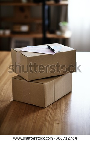 Abstract delivery object and document - stock photo
