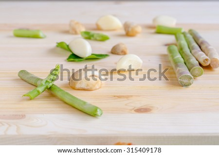 abstract design background vegetables on a wooden background, vintage tone - stock photo