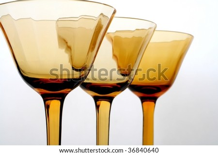 Abstract design made of brown glasses on white background.